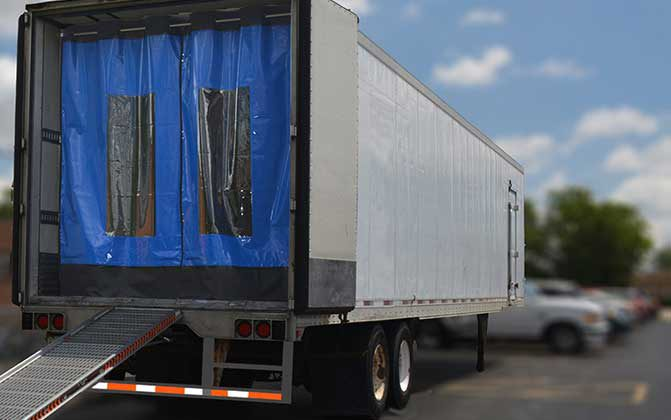 Trailer curtains help form a barrier between the cool air within the trailer and the warm, humid outside air